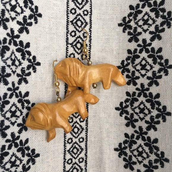 Jewelry - (2/$10) Hand carved lion earrings - vintage